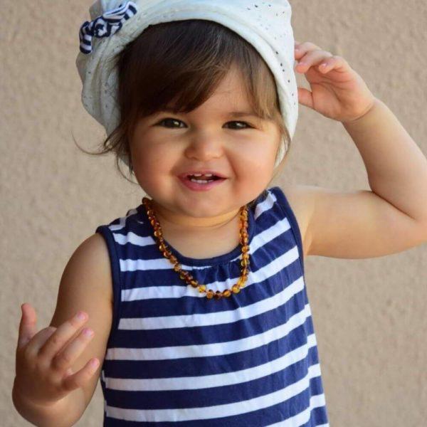 Collier d'Ambre porté par un bébé
